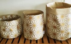 Gold geometric print storage basket lined with calico. These baskets have many used from the bathroom for holding makeup and cotton wool, the living room as a plant pouch and in the entrance hall, great to hold keys and sunglasses in!  Spot clean only is recommended. If using for a plant please use a liner and take out to water.  Handmade using linen cotton canvas and a calico liner. Price is for 1 pouch only. There are 3 sizes to choose but always happy to work with a custom order.