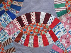 Colorful feed sacks of a wedding ring quilt top sold on Ebay by evintage
