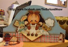 A hand painted timber plaque picturing a cute cook and her assistants.