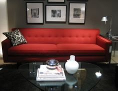Masculine and Modern Living Room with Gray Walls, Black Lacquer Furniture, and Red Sofa