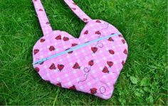 Easy Heart Bag - Show your love by sewing this Easy Heart Bag for the sweetie pie in your life. This project is ideal for beginning sewists and people who would like to create a simple, cute bag for their loved ones. This tutorial will teach you how to make a padded bag shaped like a heart. This DIY bag closes with a zipper, so it's a great way for your little one to keep everything in one place.