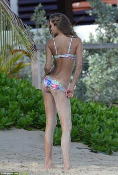 Josephine Skriver - toyed with the sides of her bikini bottoms...