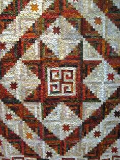 This appears to combine Summer Lake Log Cabin from Judy Martin's Log Cabin Quilt Book (center and layout) with Wilderness Log Cabin from The Creative Pattern Book (star in Log Cabin blocks).
