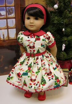 This darling vintage style dress is made of a retro styled Santa print with Christmas trees and presents. The bodice has a red swiss dot peter