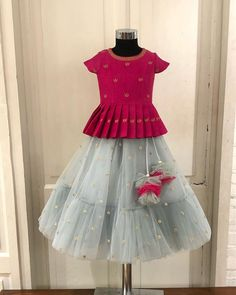 A light grey and pink peplum ghagra detailed with net Pom Pom's… Kids Dress Wear, Kids Gown, Kids Wear, Girls Frock Design, Baby Dress Design, Baby Frocks Designs, Kids Frocks Design, Frocks For Girls, Dresses Kids Girl