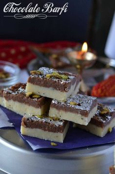Chocolate burfi is one of the popular Indian festival sweet prepared during Diwali. It is a khoya burfi or mawa burfi recipe. Chocolate burfi is two layered burfi recipe, where the bottom layer is plain mawa layer and the top layer is chocolate flavored. Chocolate Burfi, Chocolate Flavors, Edible Silver Leaf, Burfi Recipe, No Bake Energy Bites, Indian Dessert Recipes, How To Make Chocolate, Diwali, Food To Make
