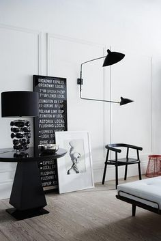http://www.topsonlighting.com/wall-lamp/serge-mouille-two-arm-wall-lamp