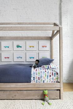 Chango & Co. renovated a young family's loft in Dumbo, Brooklyn, adding a canopy bed from RH Baby & Child and bedding from Pottery Barn Kids in the boy's bedroom. Car artwork from Leslee Mitchell carries out the transportation theme. #dwell #howtodesignakidsroom #kidsroom #moderndesign #howto #diy #designtips Boys Room Design, Loft Design, Design Design, Rh Baby, Baby Boy, Daughters Room, Dining Nook, White Furniture, Furniture Design