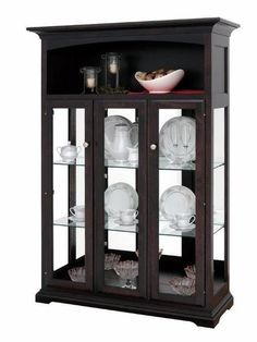 Amish Three Door Curio Cabinet Updated for a modern collection, the Amish Three Door Curio Cabinet offers custom options. Choose the glass, hardware, lighting, shelves and more. Amish made furniture. Crockery Cabinet, Curio Cabinets, Cabinet Doors, Amish Furniture, Furniture Making, Dining Table Chairs, Tables, Vintage Plates, Contemporary Style