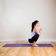 Wide Squat: This relaxing lower-back release also targets the oh-so-tight hips. Try it in the shower after a run — the hot water feels amazing on your lower back.