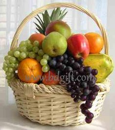 Basket of fresh fruits. Basket Includes: 1 kg Apples,1 kg Malta,Half kg Grapes, 12 pieces banana, one medium size papaya and 1 piece Bedana (Large size). (basket may vary).