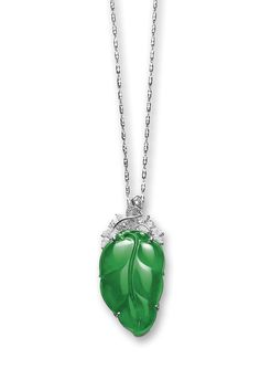 JADEITE 'LEAF' AND DIAMOND PENDANT The highly translucent emerald green jadeite carved as a leaf, surmounted by a cluster composed of marquise-, pear-shaped and brilliant-cut diamonds, mounted in 18 karat white gold. Leaf approximately 41.00 x 24.46 x 4.91mm. LOT SOLD. 4,100,000 HKD