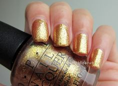 OPI. Skyfall Collection. Goldeneye. Just got this tonight. Painted one nail and I was hooked. Surprising for me seeing this is a gold and a glitter.