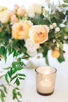 Pale Peach and Yellow Centerpiece | photography by http://rachelhavel.com