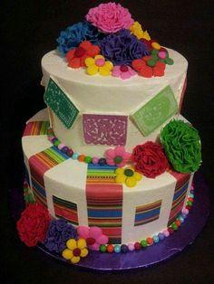 Tema mexicano pastel con flores y banderines