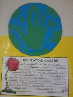 """Lorax writing.... The globe is an idea I got from Pinterest! Yay Pinterest! We read the Lorax and talked about ways we could show how we """"care a whole, awful, lot"""" about our community, Earth,   the environment, etc. Students wrote a  paragraph about it and we put their work on display around the Lorax door! =)"""