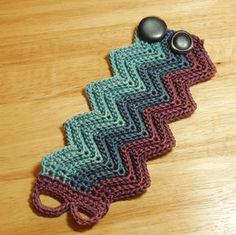 Ripple Crochet Bracelet Cuff by Etsy's IceIce Would be neat to work out something like this in the 'Apache Tears' stitch pattern! Guêtres Au Crochet, Crochet Ripple, Crochet Stitches, Crochet Patterns, Crochet Boot Cuffs, Crochet Boots, Crochet Collar, Bracelet Crochet, Wrist Warmers