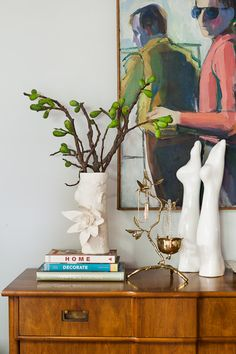 Emily Henderson styled bedroom corner with vintage 60's painting