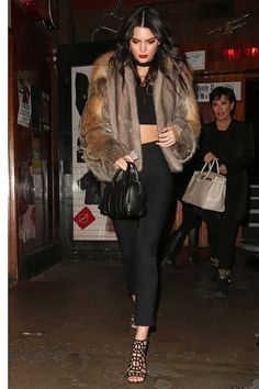 Kendall Jenner Street Style Black Crop Top Trousers Sergio Rossi Heels Givenchy Bag and Sally LaPointe Fur Coat Leggings Black Cage Heels | BodyRenn Crop Til You Drop Black Crop Top | Urban Style Street Style Inspo Street Fashion Off Duty Model Look Celeb Celeb Style Women's Fashion Women's Style Crop Top Outfits #BodyRenn #KendallJenner #StreetStyle #CelebStyle #Celebs #UrbanStyle #StreetFashion #CropTop #OffDutyModel #Models #CropTopOutfits #WomensFashion #WomensStyle #SpringStyle