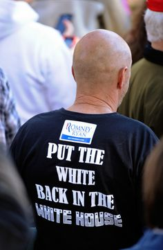 """Racist backlash: Man wearing a """"Put the White Back in the White House"""" T-shirt beneath a Romney-Ryan sticker. Photo taken  Getty photographer at a Romney campaign event in Lancaster, Ohio, in Oct. 2012"""