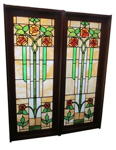 Arts & Crafts Rose Leaded Glass Windows. Two Stained Glass Windows With Floral Design and Jambs(15050 & 15051) With Jamb: 31 1/2″ wide x 80″ tall; Without Jamb: 29 1/2″ wide x 76 1/2″ tall One window does show a few cracks at the bottom