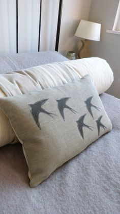 hand printed swallow silhouette cushion  £56.00