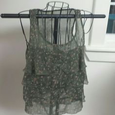 Chiffon type tank This dressy tank would make a great shell for any dark suit.  Dark green. .with small flowers.  Size small..great condition.   Unlined Mossimo Supply Co Tops Tank Tops