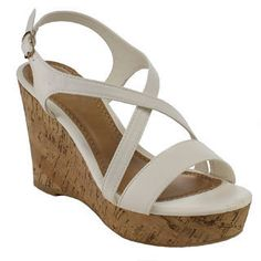 Kick up your heels with these white faux-leather wedge sandals.