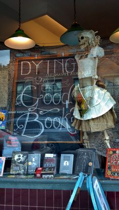 Halloween window display at Annie Bloom's Books in Portland, OR. The skeleton's dress is made out of book pages.