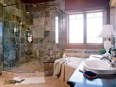 The master bathroom features a deep tub underneath and a glass encased shower.
