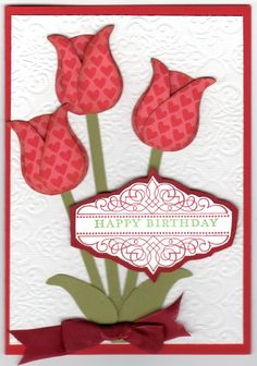 This is another one of those ideas I found on Pinterest and simply had to make my own. Tulips made using the Stampin Up's Owl punch,