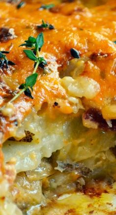 Bacon Cheddar Scalloped Potatoes ~ Layers of thinly-sliced potatoes are smothered in a creamy cheddar cheese sauce with bits of crispy bacon thrown in