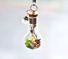 Terrarium Necklace Unique Nature Gift Crystal Jewelry Real Dried Flowers and Moss Miniature Glass Bottle Necklace Fairy Garden Pendant by teenytinyplanet on Etsy https://www.etsy.com/listing/207745920/terrarium-necklace-unique-nature-gift