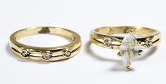 Lot 172: 14k Gold and Crystal Rings; Two ring set, one having a marquis cut crystal and two round cut crystals, the other having three round cut crystals