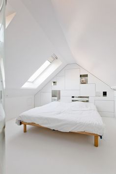 Brussels-based studio M Architecture has recently designed this open ensuite bedroom located in the attic of a dwelling in Masnuy-Saint-Jean, a village near the town of Jurbise in the province of Hainaut, Belgium.