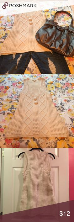 Cream knit button sweater tank Lovely knit cream-colored tank! It is long, but not quite tunic length. So cute with a pair of jeans or leggings! ✨ In very good condition. Price firm. Tops Tank Tops