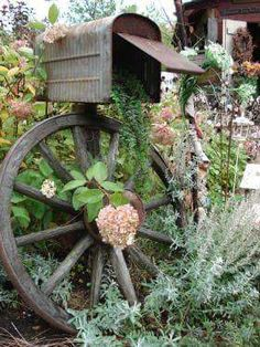 Rustic garden ♡ rusty galvanized metal mailbox ♡ wooden wagon wheel ♡ hydrangeas
