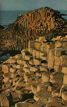 Giant's Causeway, that lighthouse looks so tiny on the other side of these enormous rock formations.