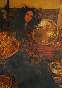 Soft echoes of flowers traced on voile, surrounded by dazzling hardware of Turkey at the stall of Abdullah in the old section of the Grand Bazaar, Istanbul. Dress designed by Foale & Tuffin.