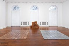 Carl Andre: a floor-based sculpture in copper (on the left).