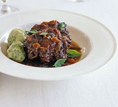 Braised oxtail with basil dumplings recipe - Recipes - BBC Good Food Braised Oxtail, Oxtail Stew, Slow Cooker Recipes, Beef Recipes, Cooking Recipes, Slow Cooking, Gourmet Recipes, Recipies, How To Stew Apples