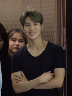 the girl in the back is shook by his perfection and so is yhe rest of the world .