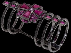 Black gold double ring pave` with black diamonds and connected by the symbol of Maltese Cross, set with rubies and pink sapphires. An additional cross is concealed along the linear pattern of the ring Black Gold Jewelry, Golden Jewelry, Nice Jewelry, Types Of Gold, Types Of Metal, Color Verde Claro, Pave Ring, Pink Sapphire, Jewelry Trends