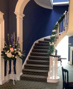 Eastclose Country Hotel staircase with flowers created by Poppies Florist Bournemouth and Christchurch
