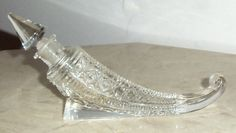 This is a lovely sterling perfume bottle in an unusual shape and design.
