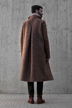 Roberto López Etxeberriapresented a luxurious Fall/Winter 2013 collection during Madrid Fashion Week, featuring beautiful outerwear made withwool, leather and fur. Lookbook by Rainer Torrado.