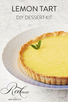 This Lemon Tart will never go out of style! We use real lemons to make a luscious and thick lemon curd that perfectly complements a buttery shortbread crust. It'll be a major hit at your next party! Order a DIY Lemon Tart kit today at http://redvelvetnyc.com.