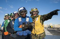 Sailors prepare to fight a simulated fire on the flight deck of the aircraft carrier USS Harry S. Truman (CVN 75).