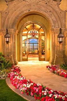 Great example of how a simple improvement---in this case, the addition of rosy flowers---can make an entry path more welcoming and memorable.