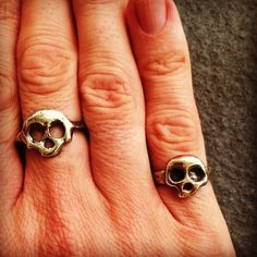 Cast sterling silver skull rings.